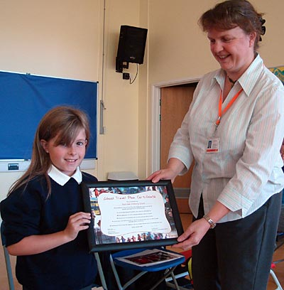 Mrs Deeley presented us with a certificate to celebrate our School Travel Plan - Red Oaks Primary School